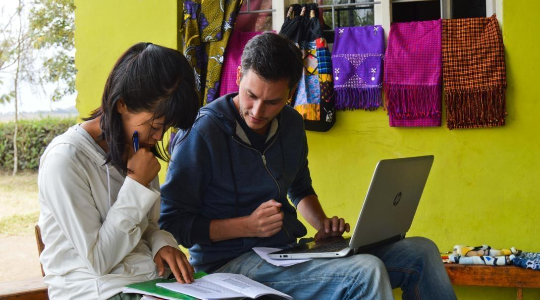 Projects Abroad volunteers enter data into the Global Impact Database while visiting a project